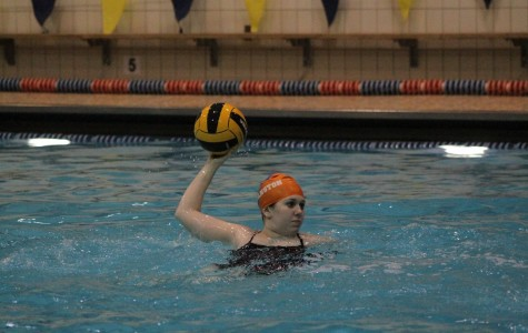 Senior Madelaine Wood launches a throw at practice.