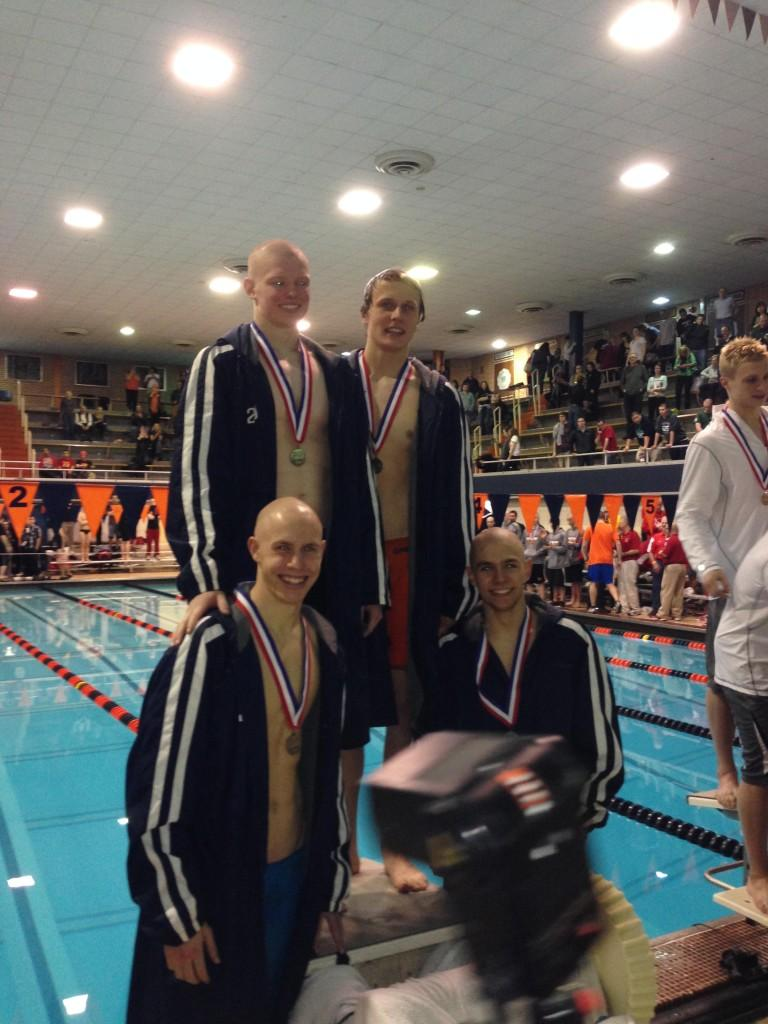 The  400 free relay team wins second place medals at the state competition.