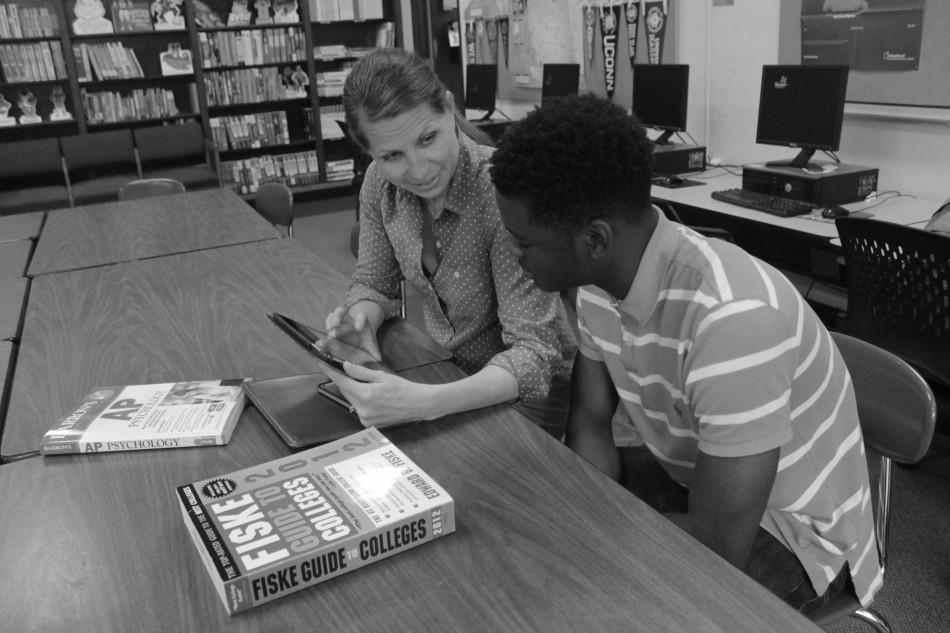 College and Career coordinator Beth Arey helps Marcus Starks, junior, with post-secondary plans.