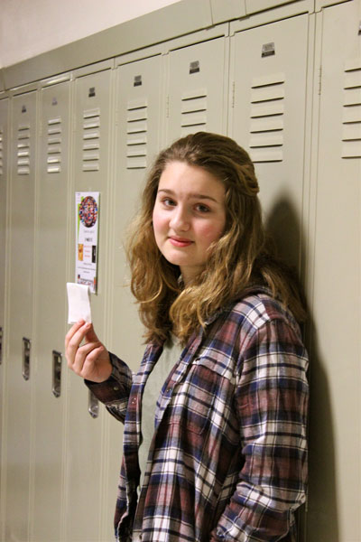 Junior Ceci Hansen holds her tardy pass.