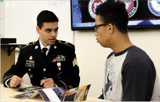 Sgt. Carlos Rubio and junior Jaalen Banner discuss military options.