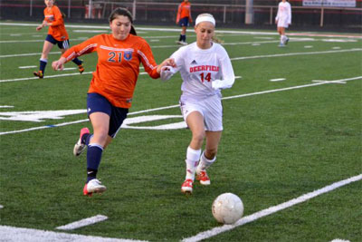 Jamie Donohue (left) chases the soccer ball.
