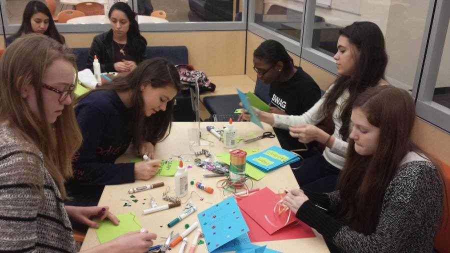 Community Service Club students make holiday cards for hospitalized children.