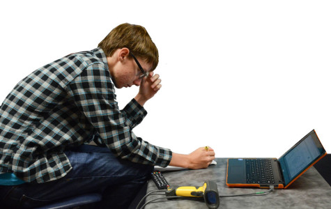 A student does repairs on a Chromebook.