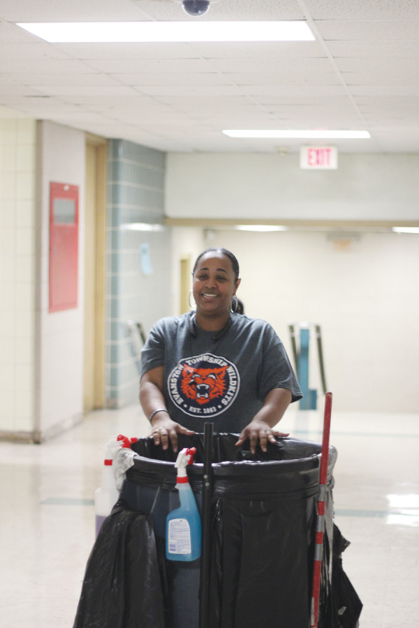 Denean Henry works during the nights to keep classrooms and hallways clean.
