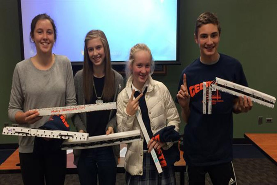 Top bridge builders in the ETHS Straw Bridge Building and Breaking Contest pose with their bridges. From left, Becca Miller, Leah Altman, Arden Cusick and Joe Leibforth.