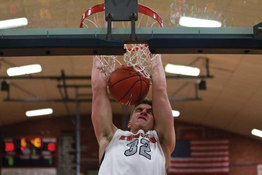 Center Dylan Mulvihil dunks.