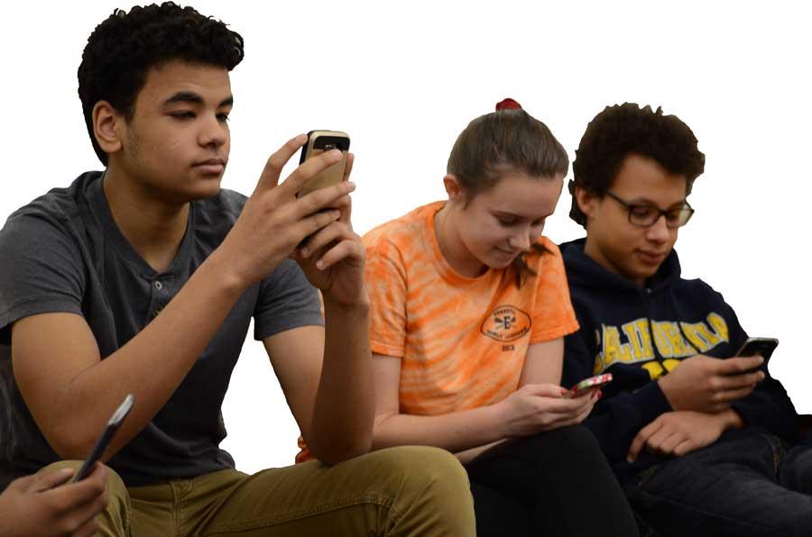 Nathan Romero, sophomore, Caroline Moore, senior, and Khalil Royster, sophomore