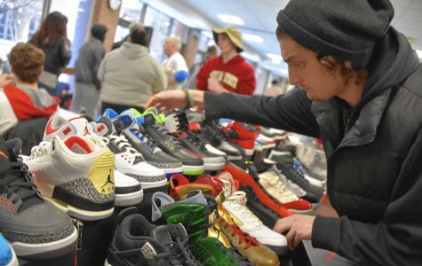 A vendor at last year's Sneaker-con prepares shoes for resale.