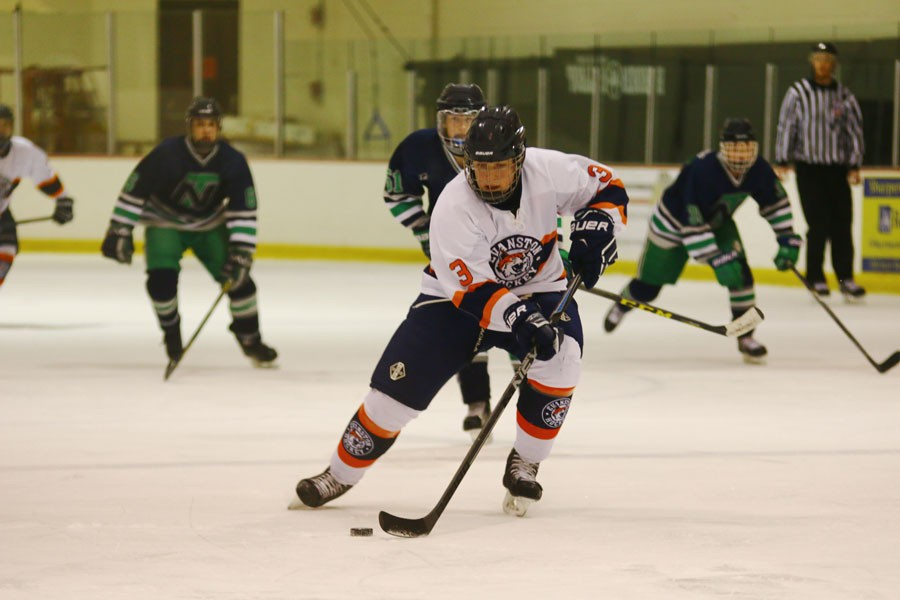 Sophomore Joe Epler skates past a New Trier defenseman.