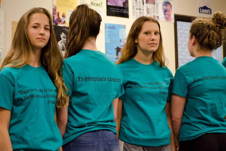 Juniors Grace Giangreco, Catherine Cushing, senior Emily Sommer, and junior Maddie Lee, members of the C.A.R.E. club, wear shirts to promote sexual violence awareness.