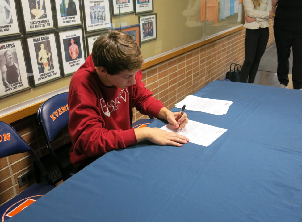 Turner Dobbs signs his commitment papers