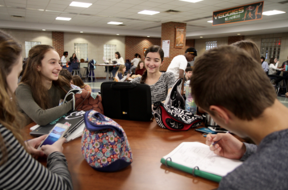 A group of students eat lunch in the South Study Cafe