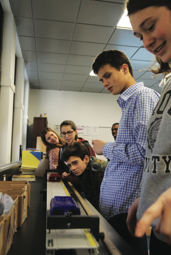 A group of AP Physics students participate in a lab