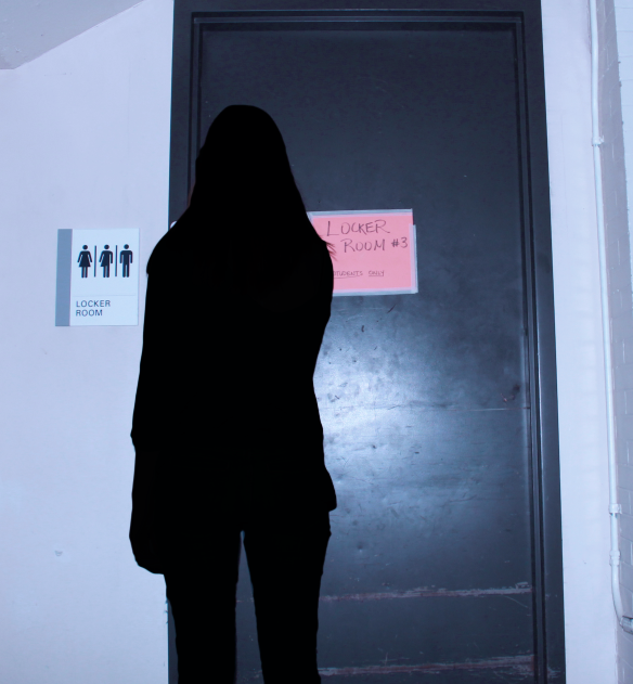 A student approaches locker room 3