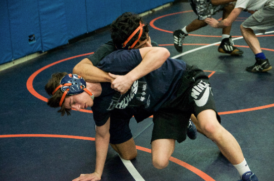 Jack McCleish (bottom) and Chris Rivera (top) wrestle each other at practice