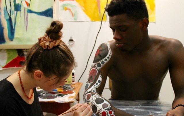 Senior Olivea Frischer practices her artistic skills in preperation for her project on Senior James Ogunbola.
