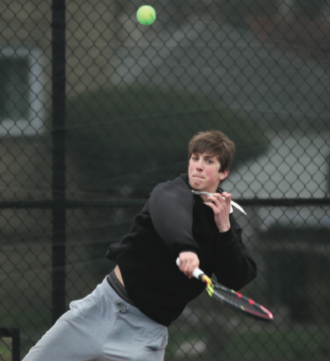 Junior Cameron Behr prepares for an upcoming match