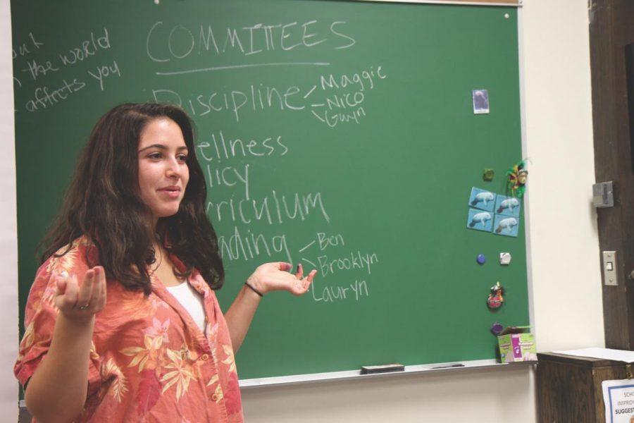 Senior Nadia Goldberg leads a meeting.