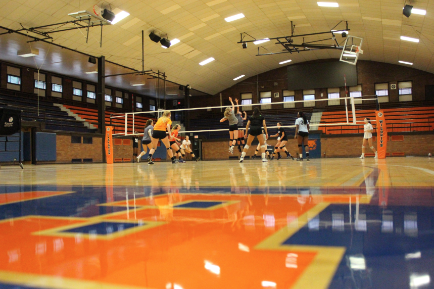 Girls+volleyball+practices+in+the+newly+renovated+gym.