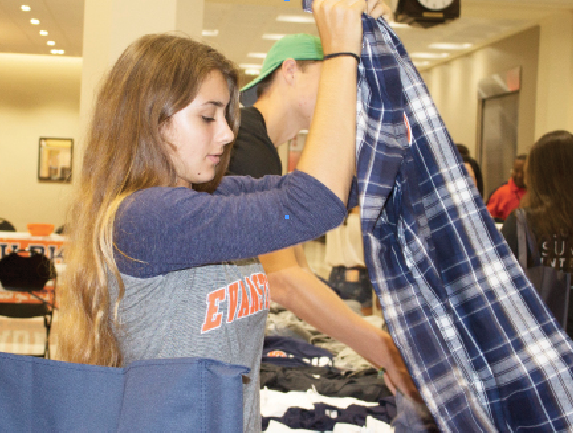 Junior Hadley Bushala cuts her summer short to help with freshman orientation.