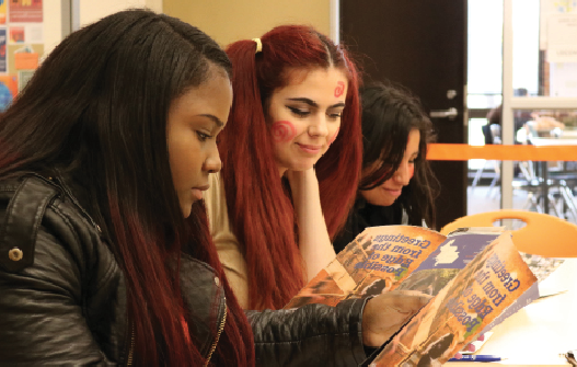 Students listen to a presentation in the Hub.