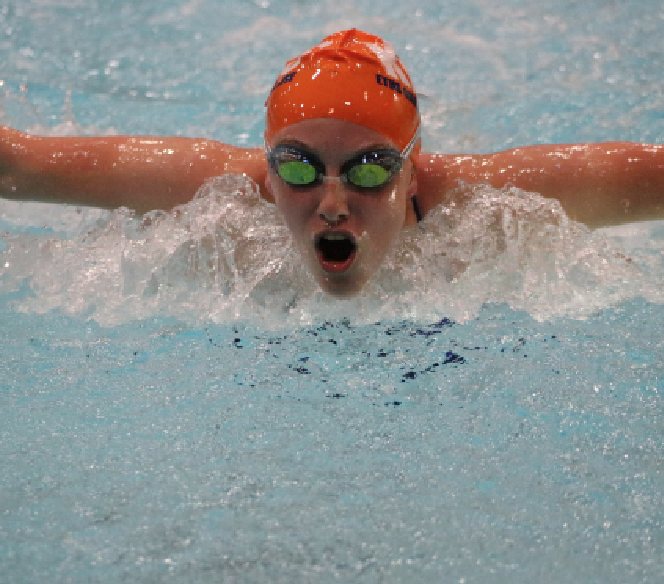 Junior Sydney Hollingsworth competes at a meet.