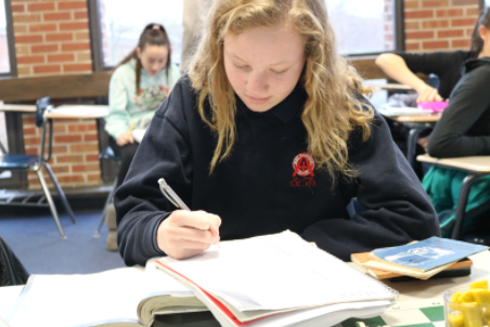 Former St. Athanasius student does classwork after transitioning to public school