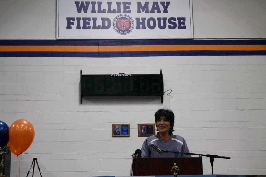 Norma May speaking at the  ceremonial dedication of the Fieldhouse to Willie May.