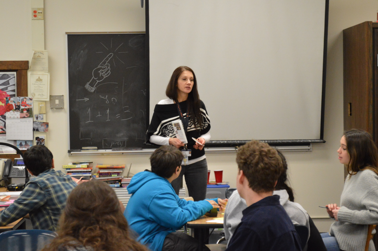Hebrew teacher Anna Raiber addresses the class.