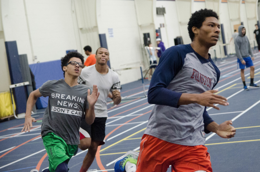 Members of the ETHS track team sprint during practice.