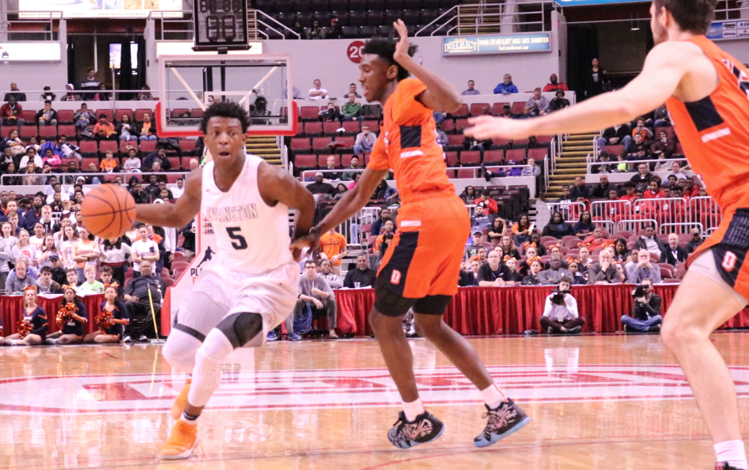 Senior Lance Jones dribbles past defenders at the state semi-final game last spring.