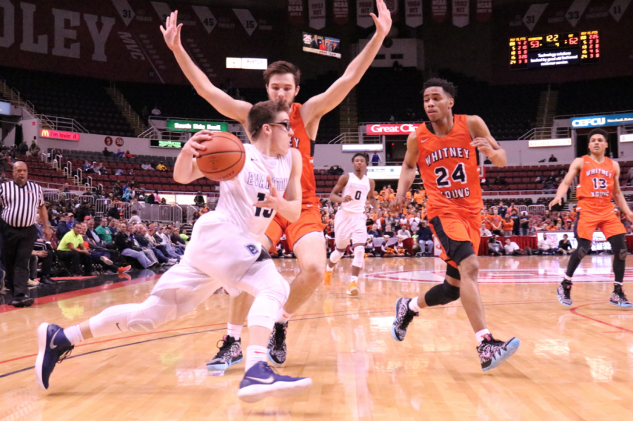 Freshman Blake Peters drives to the hoop.