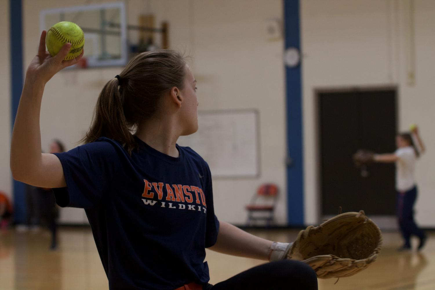 Chloe Haack plays catch at  practice