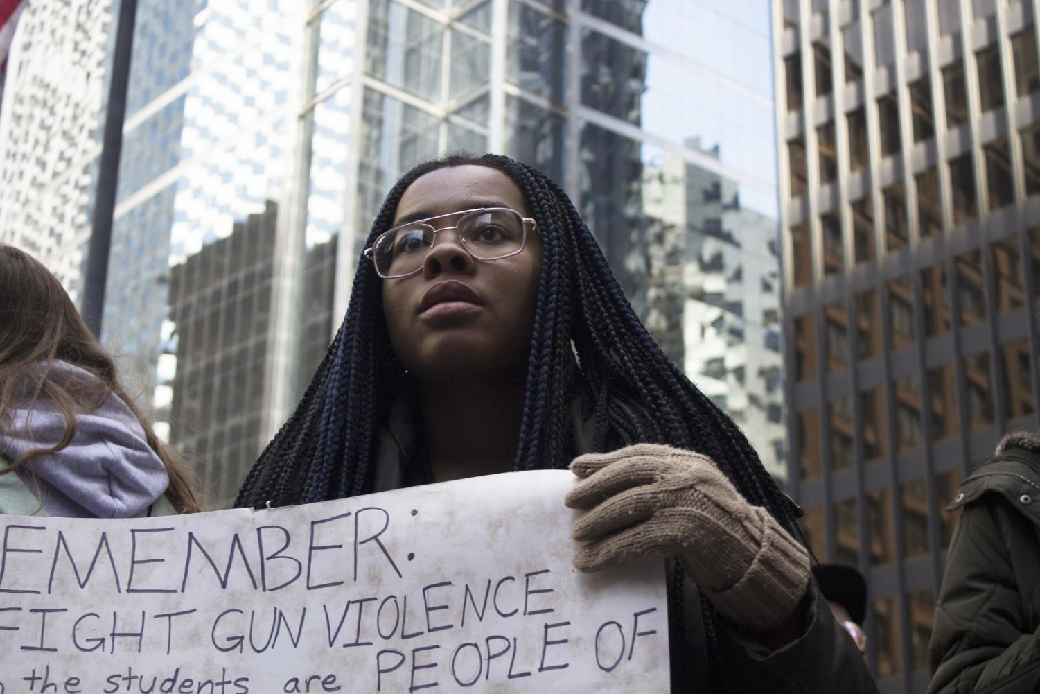 A Chicago student rallies against gun violence on behalf of people of color at the April 20 march.