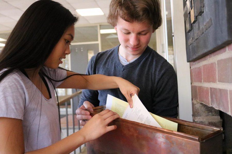 Sophomores Chris Dakich and Danielle Rivera examine the West capsule.