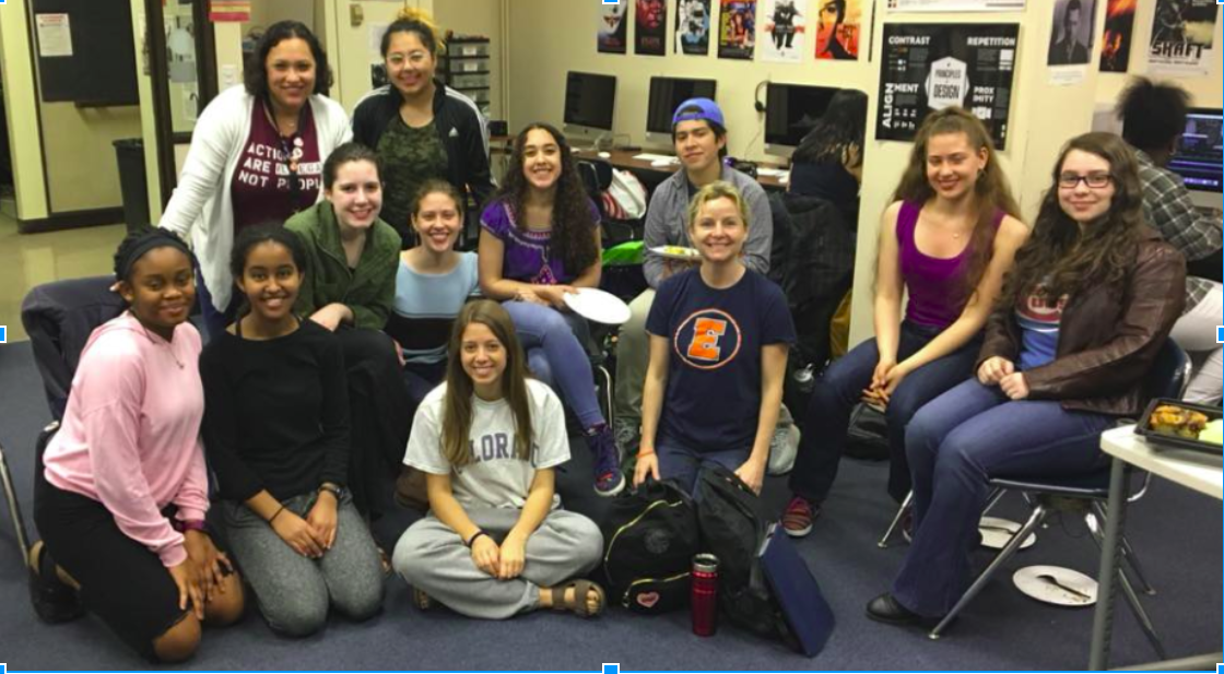 ETHS Students Without Borders (SWB) club with sponsors Michelle Vazquez (top right) and Amy Moore (fourth from the left) at end-of-year party 2018.
