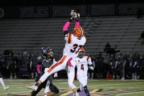 Senior Michael Axelrood elevates for a catch versus Niles North.