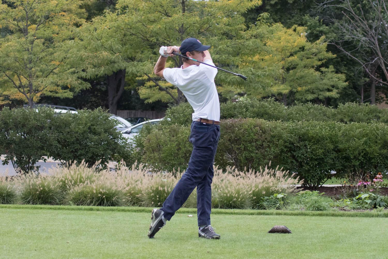 Senior captain Tommy Barbato tees off at an early season tournament.