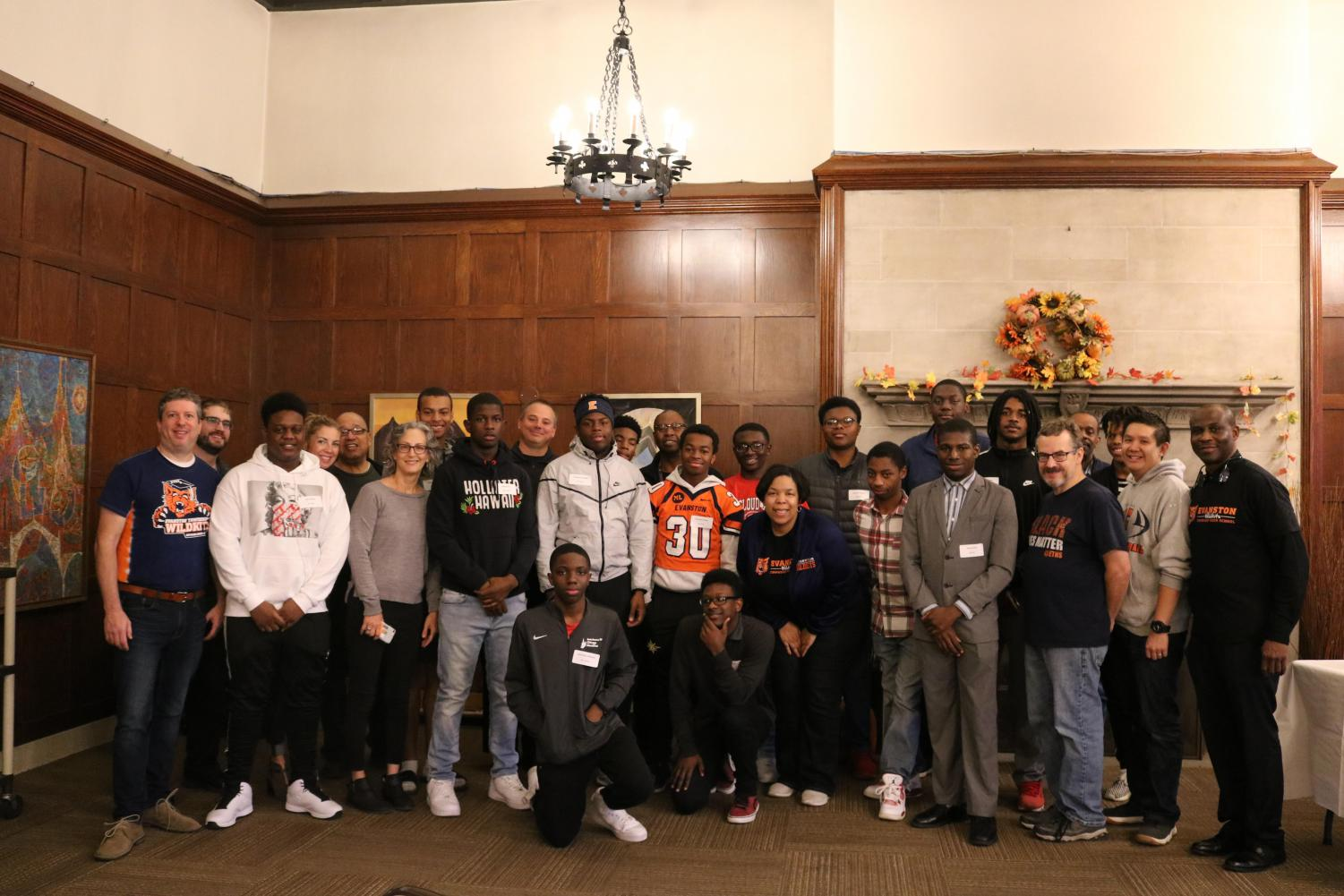 Young males in the program stand with their mentors on Oct. 26.