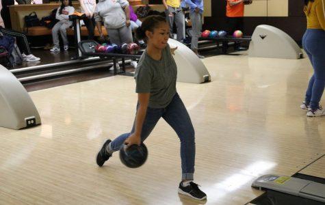 Junior Asya Wright bowls a strike.