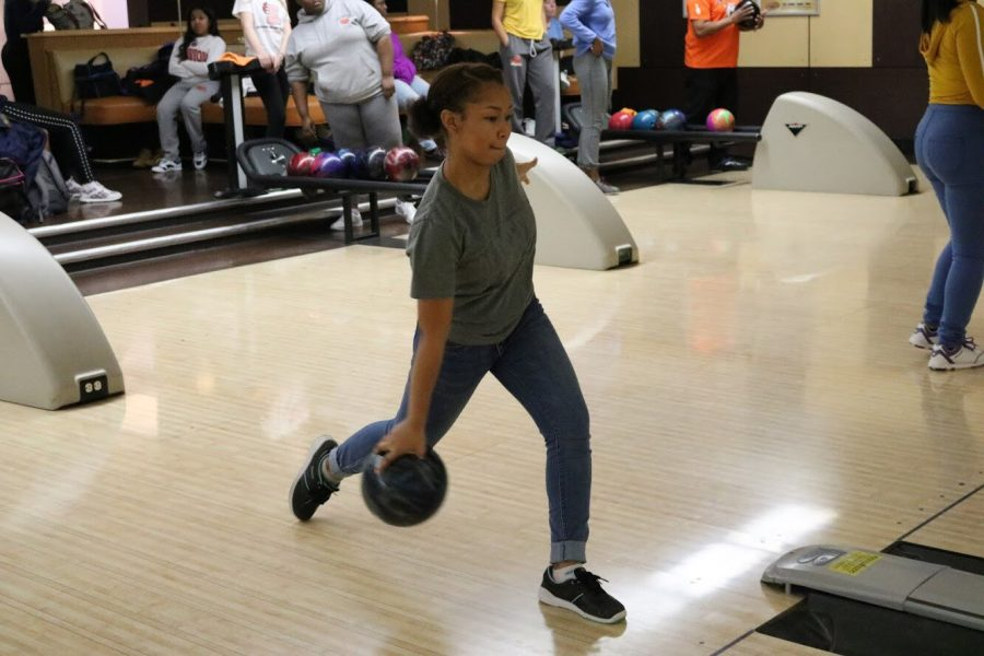 Junior Asya Wright bowls a strike.