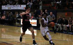 Senior Lance Jones blows by the Maine South defender on his way to the hoop.