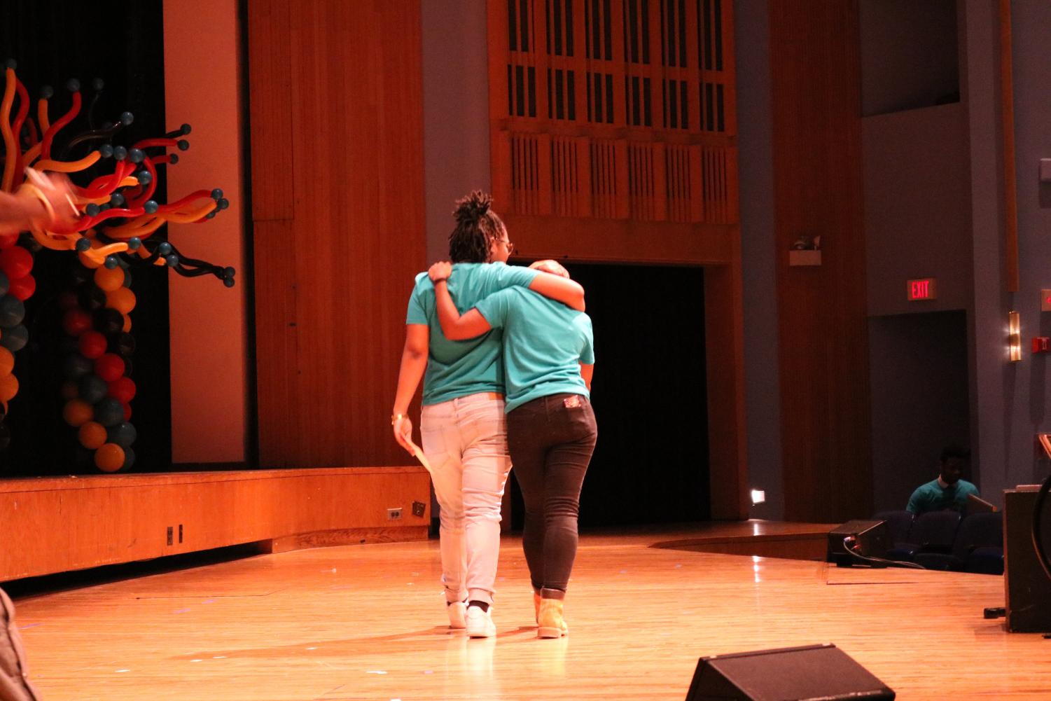 Student facilitators walking off-stage together.
