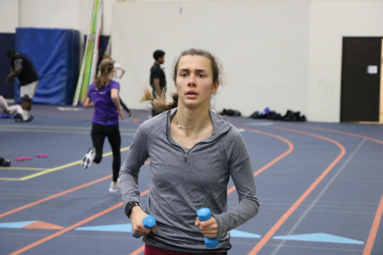 Senior Abby Osterlund runs distance at practice.