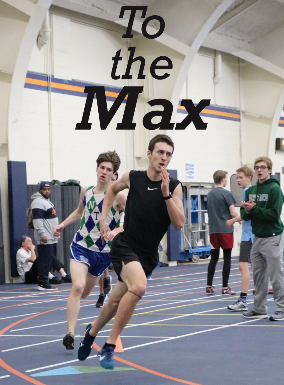 Junior Max Peterson sprints around the curve during his 1600 meter race win.