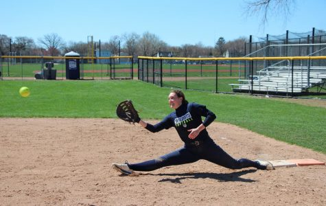 Senior Lucy Hart stretches off of first base.