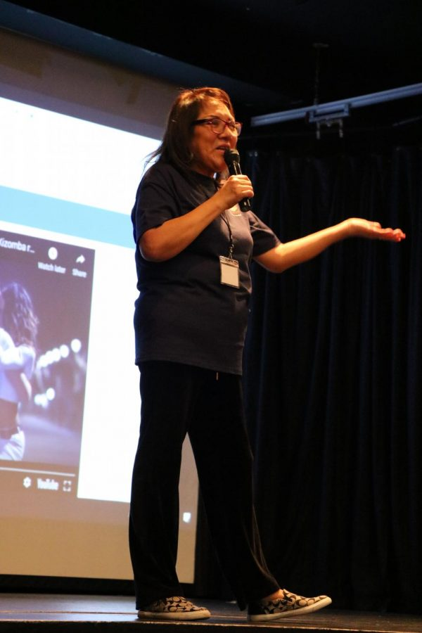 Faculty session leader Mercedes Fernández engages participants in different dances.