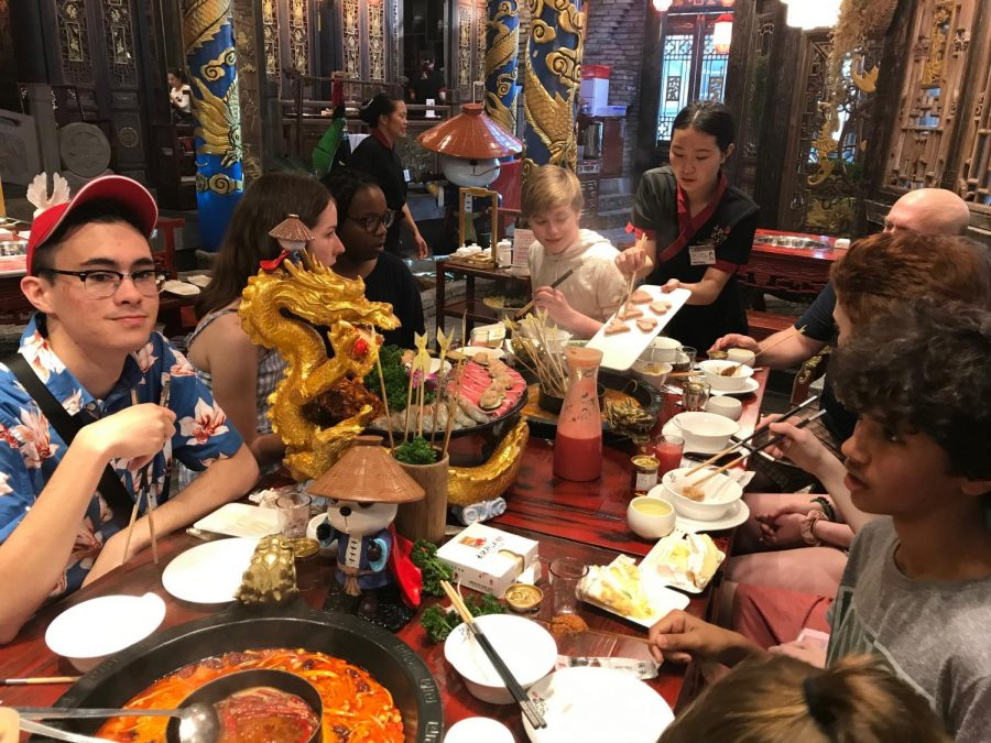 ETHS students enjoying a meal in China over the summer of 2019.