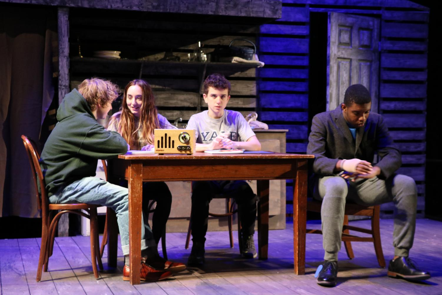 Actors rehearse a scene from The Diary of Anne Frank
